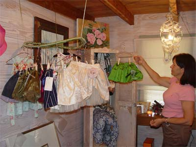 Viruchy Delgado displays children's clothing